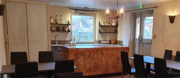 Het gezellige restaurant van Lodge Les Merisiers